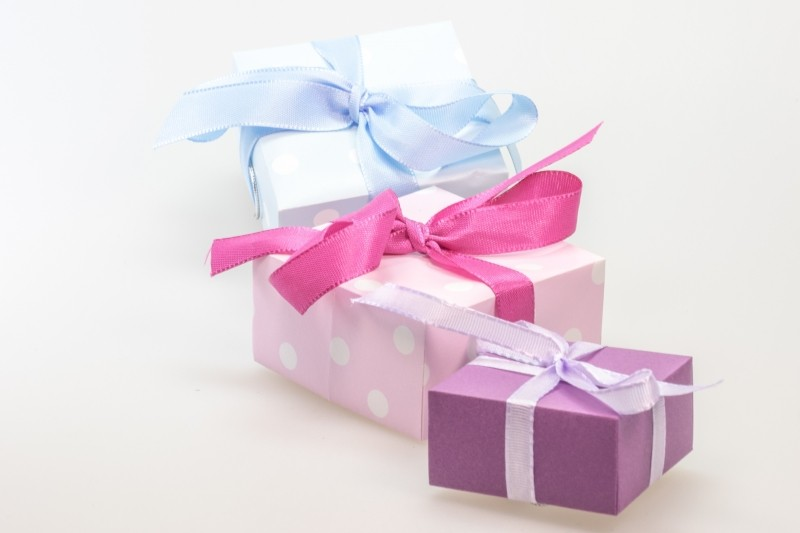 three-gifts-with-ribbons-on-white-background