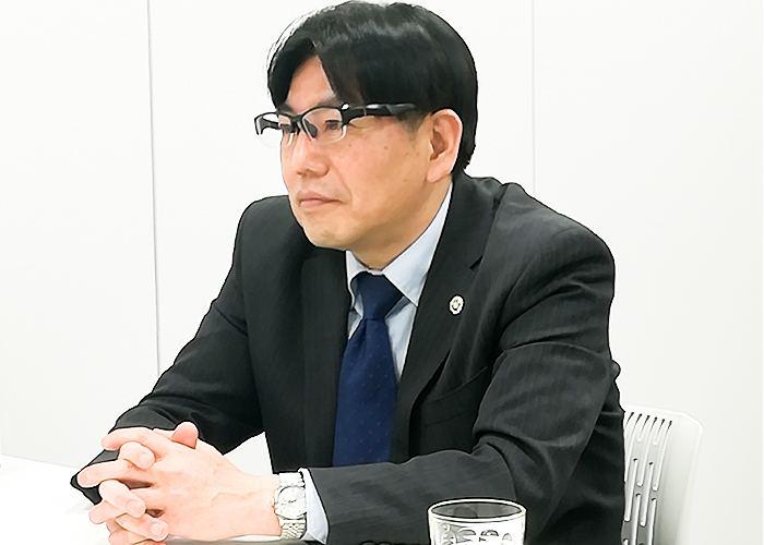 開業されたきっかけについて話す、竹田さん。